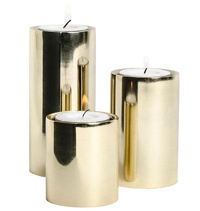 Telysholder i gullfarget metall fra Lagerhaus.
